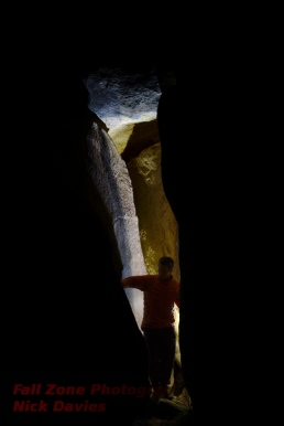 James skulking around in the dark, unknown chimney climb, Castle Hill, New Zealand