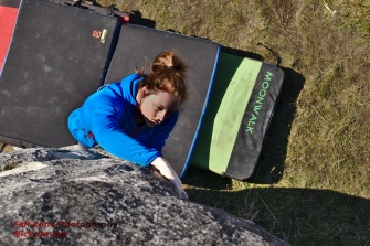 Sarah warming up for a day of bouldering by jumping on a highball. Castle Hill, New Zealand