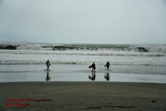 Surfers getting ready for a hard paddle, Taylors Mistake, Christchurch, New Zealand.